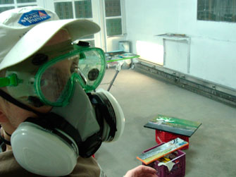 varnishing wearing a NIOSH mask